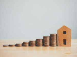 Property investment real estate and house mortgage financial concept, Money coin stack with wooden house